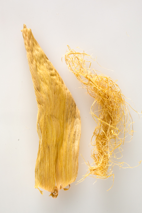 Corn husk (left) has been cooked and dried. Fillers (right) were removed soon after the beating process started.